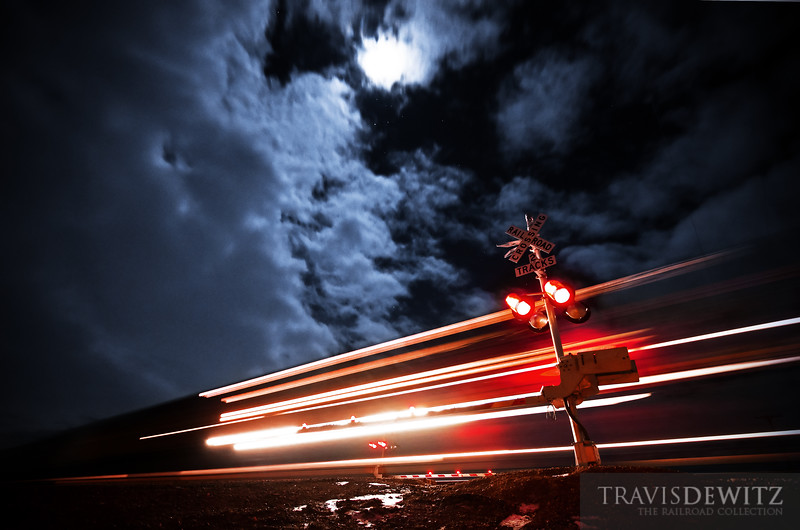 """A BNSF coal train streaks by as an almost full moon lights of the night sky.  Travis Dewitz <a href=""""http://www.therailroadcollection.com/latest-works/"""" target=""""_blank"""">The Railroad Collection</a>"""