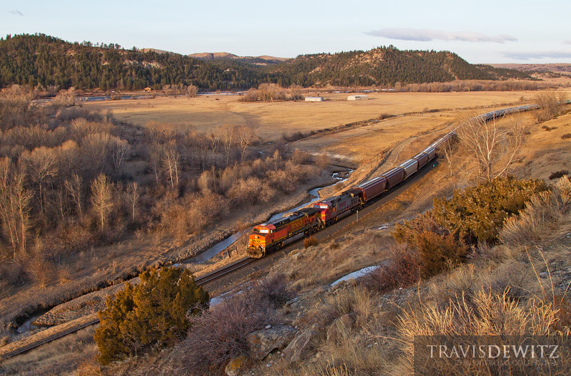 Eastbound grain train led by BNSF 5608 runs into the sunrise near Columbus, Montana.