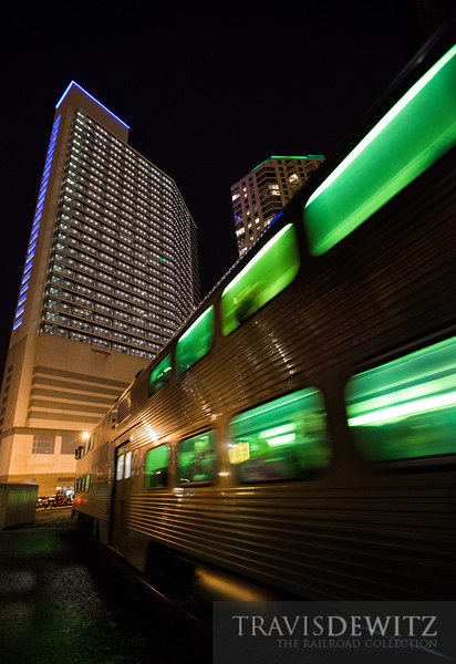 Glowing green windows flashing by as an outbound Metra train takes the tight curve out of Chicago Union Station.