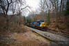 CSX 324 pulls hard up hill through the woods to the loadout at Pax, West Virginia.