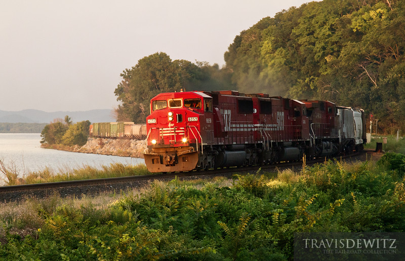 "The setting sun lights up Soo 6059 as it sails north through the curves at Maple Springs,  towards St. Paul.  Travis Dewitz <a href=""http://www.therailroadcollection.com/latest-works/"" target=""_blank"">The Railroad Collection</a>"