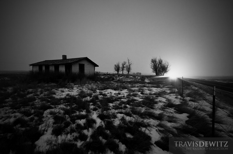 """The headlights of an oncoming train illuminates the frosty air as it rumbles past an eerie abandoned shack near Wright, Wyoming.  Travis Dewitz <a href=""""http://www.therailroadcollection.com/latest-works/"""" target=""""_blank"""">The Railroad Collection</a>"""