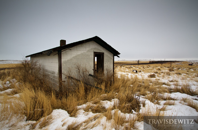 """An old abandoned shack overlooks the constant traffic of coal trains that transverse the Powder River Basin. A Union Pacific train is making it's way up the Orin Subdivision will just be another passing train today.  Travis Dewitz <a href=""""http://www.therailroadcollection.com/latest-works/"""" target=""""_blank"""">The Railroad Collection</a>"""