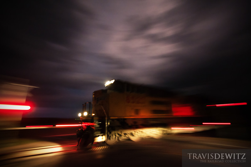 """With severe weather warnings out, Union Pacific MPRSS doesn't waste time flying through a crossing in Elk Mound, WI as they race west to Staint Paul.  Travis Dewitz <a href=""""http://www.therailroadcollection.com/latest-works/"""" target=""""_blank"""">The Railroad Collection</a>"""