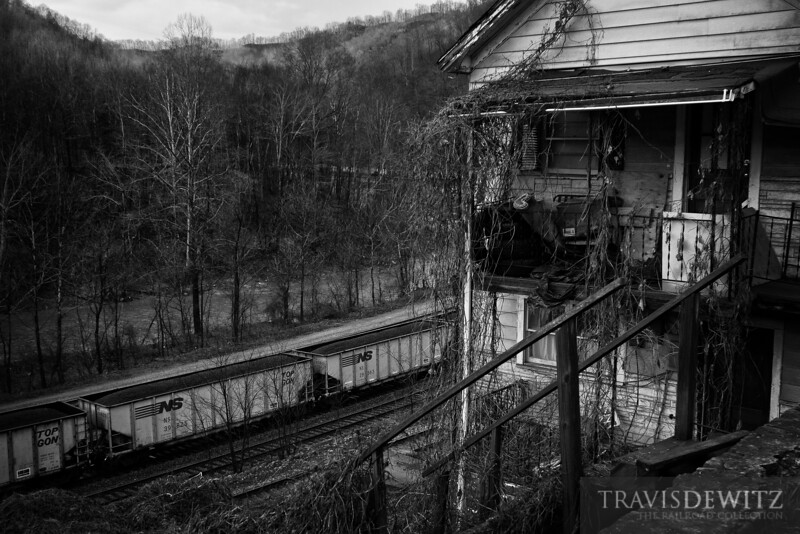 """The steep valleys throughout West Virginia do not allow for much room for homes, roads, rivers, and railroads, like seen here outside of Welch.  Travis Dewitz <a href=""""http://www.therailroadcollection.com/latest-works/"""" target=""""_blank"""">The Railroad Collection</a>"""
