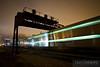 An inbound Metra train streaks under the PRR signal bridge near Racine Avenue in Chicago.