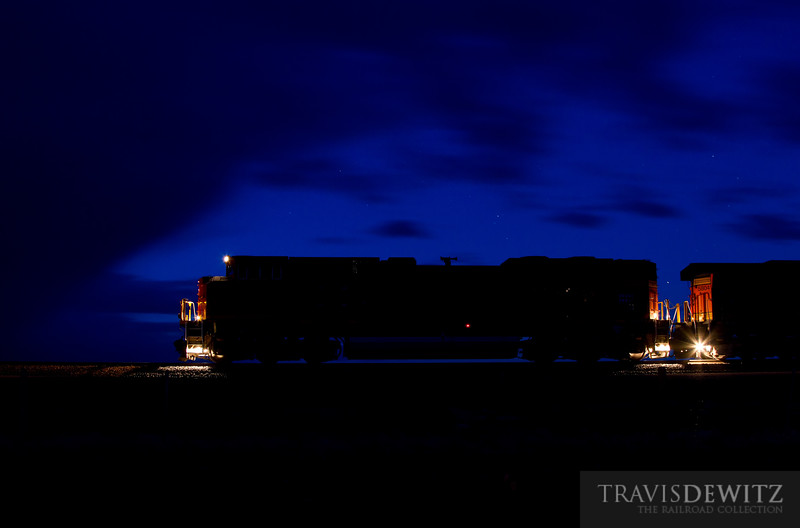 "Before dawn and before the sunrises, is the blue hour. Cameras pick up the blue light on a long exposure better then the human eye as can be seen here as this BNSF train waits to get a signal to head south towards Bill, WY.  Travis Dewitz <a href=""http://www.therailroadcollection.com/latest-works/"" target=""_blank"">The Railroad Collection</a>"