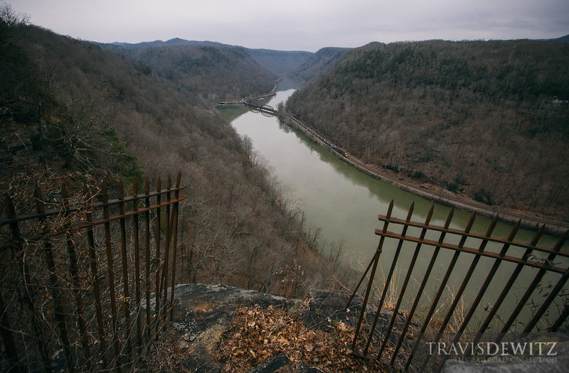 An empty CSX coal train can be seen snaking through the New River Gorge.
