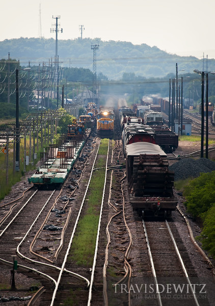 """Union Pacific MSSPR and MPRSS both have arrived in the yard at Altoona, Wisconsin. The MOW track gang has their cars on the pass as work to install new welded rail to the area is under way.  Travis Dewitz <a href=""""http://www.therailroadcollection.com/latest-works/"""" target=""""_blank"""">The Railroad Collection</a>"""