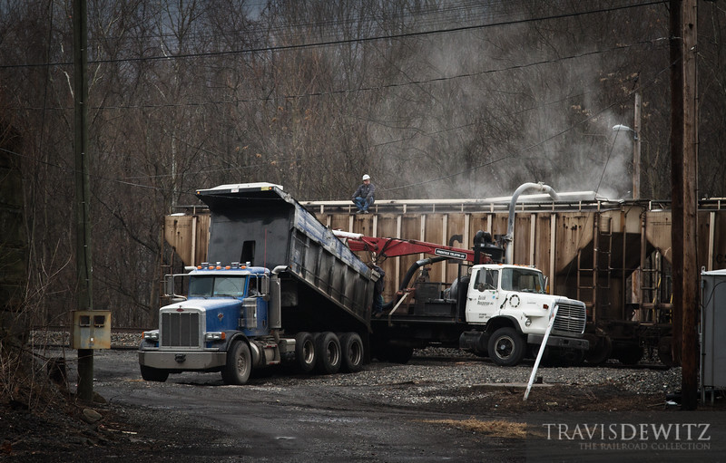 """Hoppers get loaded on a side track in CSX's yard just outside of Prince, West Virginia.  Travis Dewitz <a href=""""http://www.therailroadcollection.com/latest-works/"""" target=""""_blank"""">The Railroad Collection</a>"""