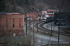Up on the hill overlooking a helper set rolling through Keystone, West Virginia and past the green coal dust curtain wall.