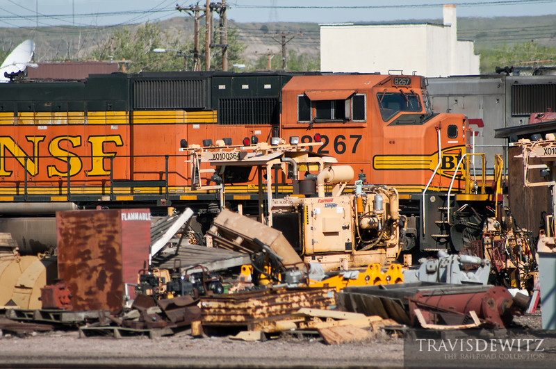 """Piles of equipment, steel, scrap, and junk are stored around the BNSF's Glendive, Montana yard.  Travis Dewitz <a href=""""http://www.therailroadcollection.com/latest-works/"""" target=""""_blank"""">The Railroad Collection</a>"""