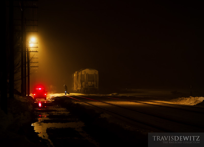 """After lining the switch for a reverse move, the conductor grabs a Transport America crew cab back to the Union Pacific yard office in Altoona, Wisconsin.  Travis Dewitz <a href=""""http://www.therailroadcollection.com/latest-works/"""" target=""""_blank"""">The Railroad Collection</a>"""