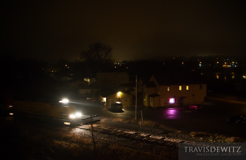 """The Union Pacific local heads North on the Chippewa Falls Sub to interchange cars with the Wisconsin Northern just south of Norma. Looks like business is slow at the Dam Bar in Chippewa Falls as the set of GP38-2 streak by in the night.  Travis Dewitz <a href=""""http://www.therailroadcollection.com/latest-works/"""" target=""""_blank"""">The Railroad Collection</a>"""