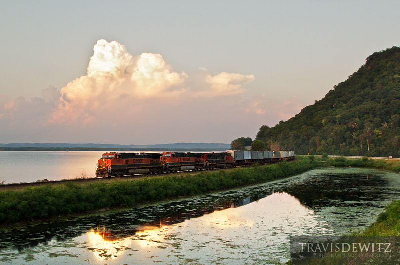 "A BNSF pig train detours up the Canadian Pacific's River Sub as a thunderstorm developes over Wisconsin.  Travis Dewitz <a href=""http://www.therailroadcollection.com/latest-works/"" target=""_blank"">The Railroad Collection</a>"