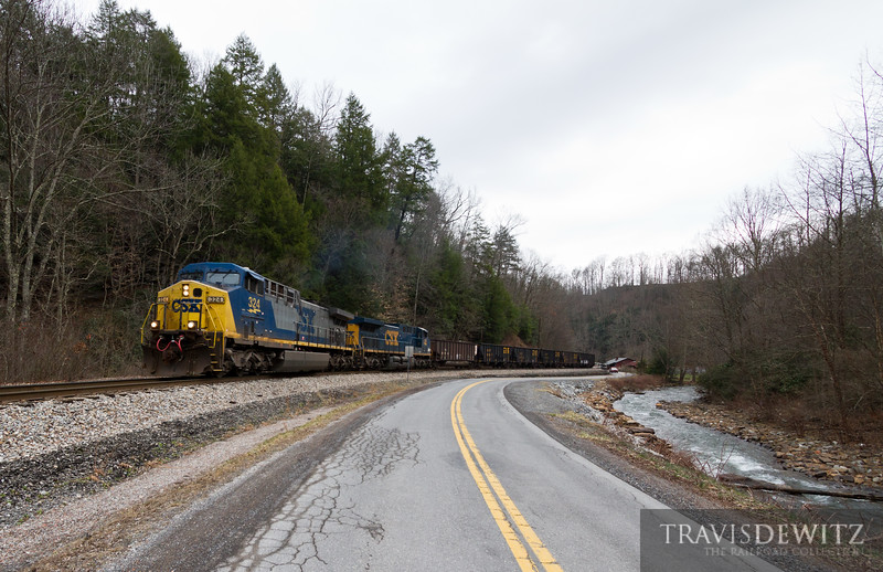 A RJ Corman crew takes empty coal hoppers up grade along Loup Creek towards Pax, West Virginia.