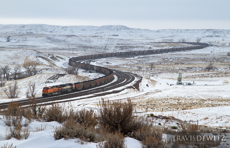 """BNSF 6422 snakes loaded hoppers out of the Powder River Basin just south of Donkey Creek Jct. during a light snow fall.  Travis Dewitz <a href=""""http://www.therailroadcollection.com/latest-works/"""" target=""""_blank"""">The Railroad Collection</a>"""