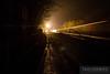 Aluminum coal hoppers streak through the night near Prince, West Virginia.