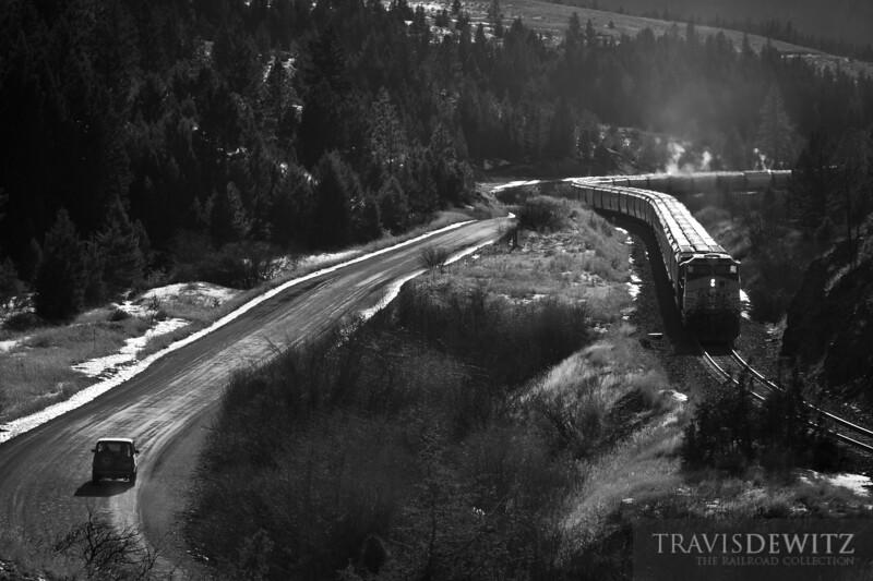 BNSF 5605 shoves hard up Mullan Pass near Austin, Montana.