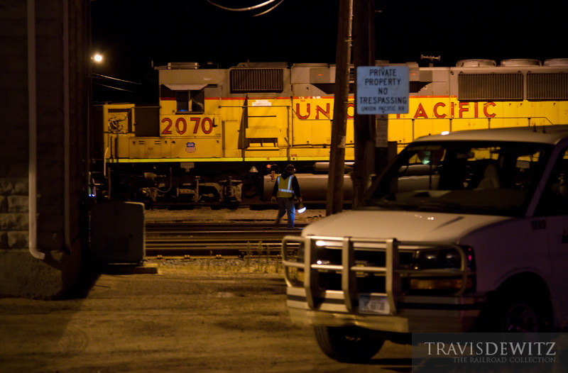 """Union Pacific crew checks their train as a Coach America crew van waits at the Altoona yard office.  Travis Dewitz <a href=""""http://www.therailroadcollection.com/latest-works/"""" target=""""_blank"""">The Railroad Collection</a>"""