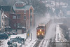 Ex-Sante Fe BNSF 791 storms up the Mississippi River kicking up fresh snow through the river town of Alma, Wisconsin on their way to St. Paul.