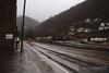 Norfolk Southern local runs through Northfork, West Virginia on a rainy dreary day.