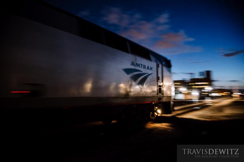 An Amtrak Hiawatha passenger train races across Racine Avenue in Chicago.
