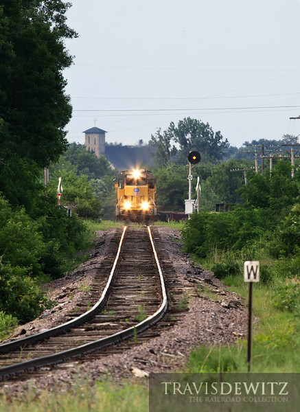 """The Union Pacific local heads back down the Chippewa Falls Sub after delivering to the Wisconsin Northern in Norma. UP 1932 can be seen climbing out of Chippewa Falls, Wisconsin with Notre Dame Church towering in the background.  Travis Dewitz <a href=""""http://www.therailroadcollection.com/latest-works/"""" target=""""_blank"""">The Railroad Collection</a>"""