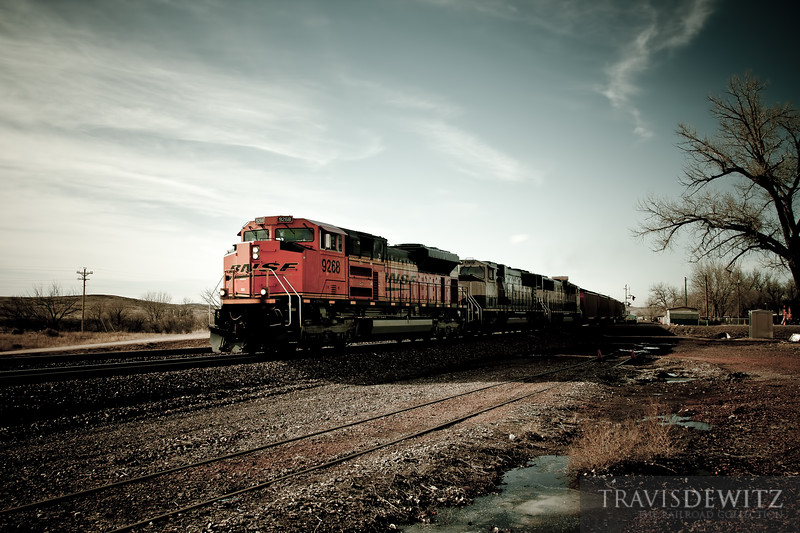 BNSF 9268 powers east through Moorcroft, Wyoming with hoppers full of Powder River Basin coal.