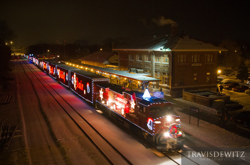 """The Canadian Pacific Holiday Train has just arrived next to the Amtrak depot in La Crosse, WI. One the train comes to a stop the band will start playing to help the food drive and for the crowd that has gathered.  Travis Dewitz <a href=""""http://www.therailroadcollection.com/latest-works/"""" target=""""_blank"""">The Railroad Collection</a>"""
