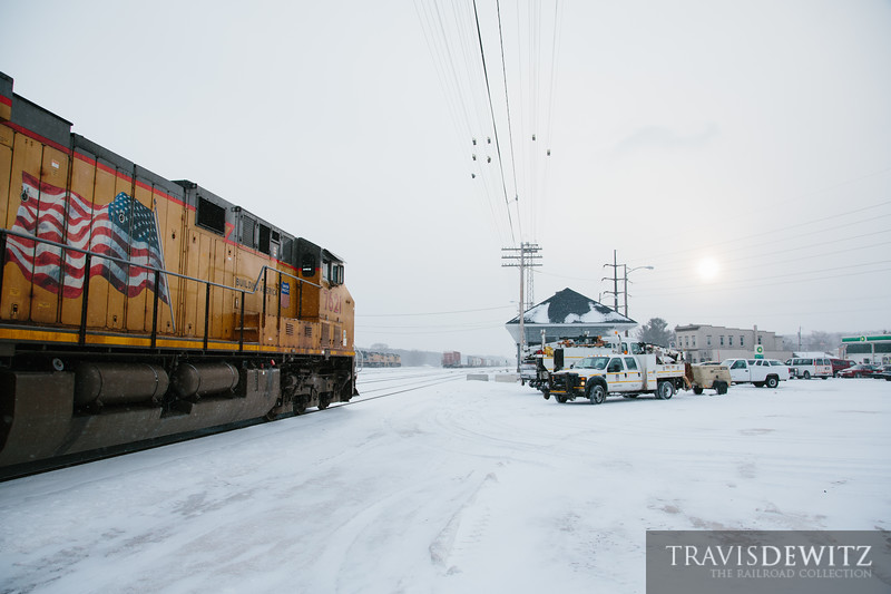 Snow keeps falling in Altoona, Wisconsin. The Union Pacific MOW are getting ready to tackle cleaning switches as the trains continue to run.