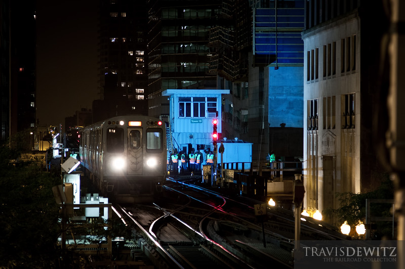 """Sparks fly and paint CTA MOW workers in a blue glow as a CTA train passes Tower 18 in downtown Chicago.  Travis Dewitz <a href=""""http://www.therailroadcollection.com/latest-works/"""" target=""""_blank"""">The Railroad Collection</a>"""