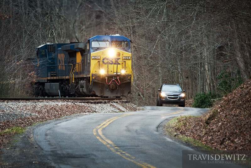 CSX 324 heads up grade from the New River Gorge on their way to the loadout in Pax, West Virginia.