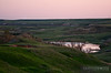 "The sun has just started to peek over the Earth's crust while a loaded BNSF coal train works through the North Dakota Badlands working east towards Belfield.  Travis Dewitz <a href=""http://www.therailroadcollection.com/latest-works/"" target=""_blank"">The Railroad Collection</a>"