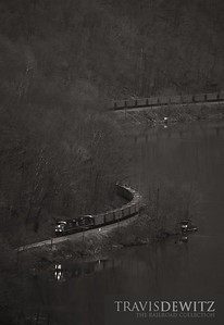 The reflection of a westbound CSX coal train can be seen on the New River near Ansted, West Virginia.
