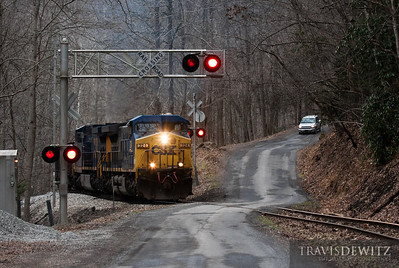 The RJ Corman crew takes the handed off CSX empty coal train up the hill from Thurmond, West Virginia to Pax to get loaded at Pioneer Fuel Company.