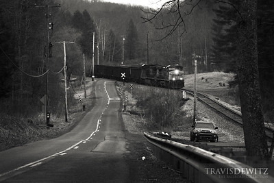 A RJ Corman employee protects a crossing as an empty coal train heads up the line to Pax, West Virginia.
