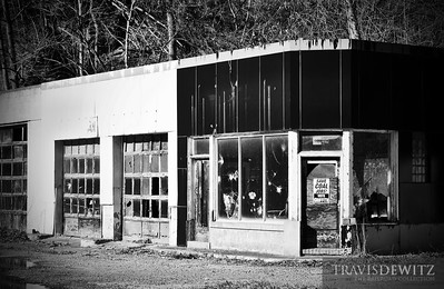 An abandonded service station sits in disrepair in southwestern West Virginia with the only hope being a sign nailed to the door. Save Coal Jobs, Vote Griffith.
