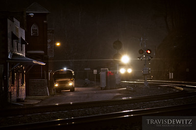 Children get pick up for school in the early dawn hours in Keystone, West Virginia while a Norfolk Southern coal train glides downgrade through the dark town.