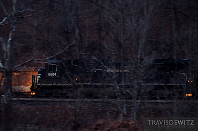 Norfolk Southern 8864 moves a string of filled coal hoppers from the Teco Mine just west of Hurley, Virginia as darkness has long ago started to set in on the hollar.