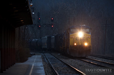 CSX 627 leads west past the Prince, West Virginia Amtrak station after a few rain showers as the setting sun ends the day.