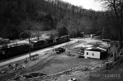 CSX 324 leads an empty RJ Corman coal train to Pax to get loaded as it climbs the hill through Harvey, West Virginia.