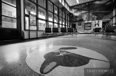 Inside the art deco inspired Prince, West Virginia Amtrak station. Here you can see the tile Chessie system logo that is part of the floor.