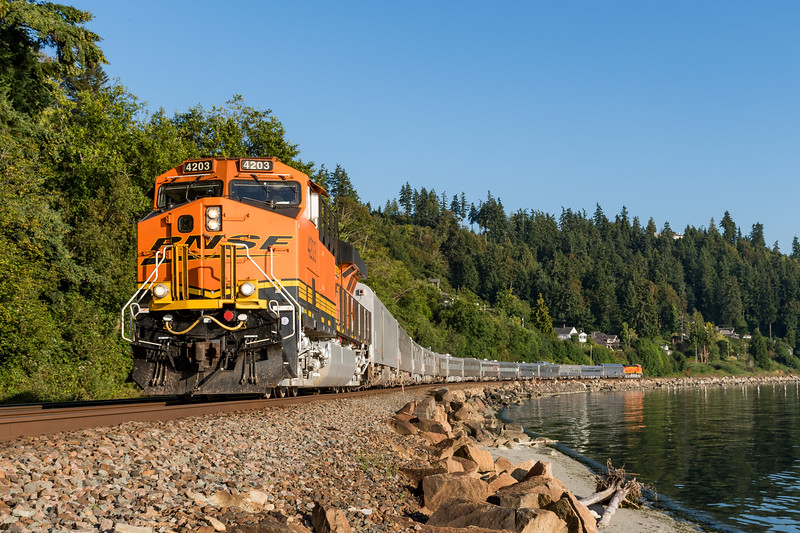 A BNSF Railway office car special makes its way north along the Puget Sound at Picnic Point Park near Edmonds, Washginton on July 31, 2018.