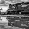 Norfolk Southern 5004 reflects in a puddle at Strawberry Ridge, Pennsylvania.