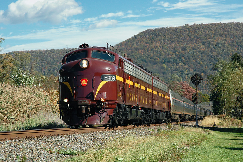 Restored Pennsylvania Railroad E8s power the Flaming Foliage Express excursion northbound to Renovo on the Norfolk Southern Buffalo Line, seen here at Farwell, Pennsylvania on October 14, 2006.