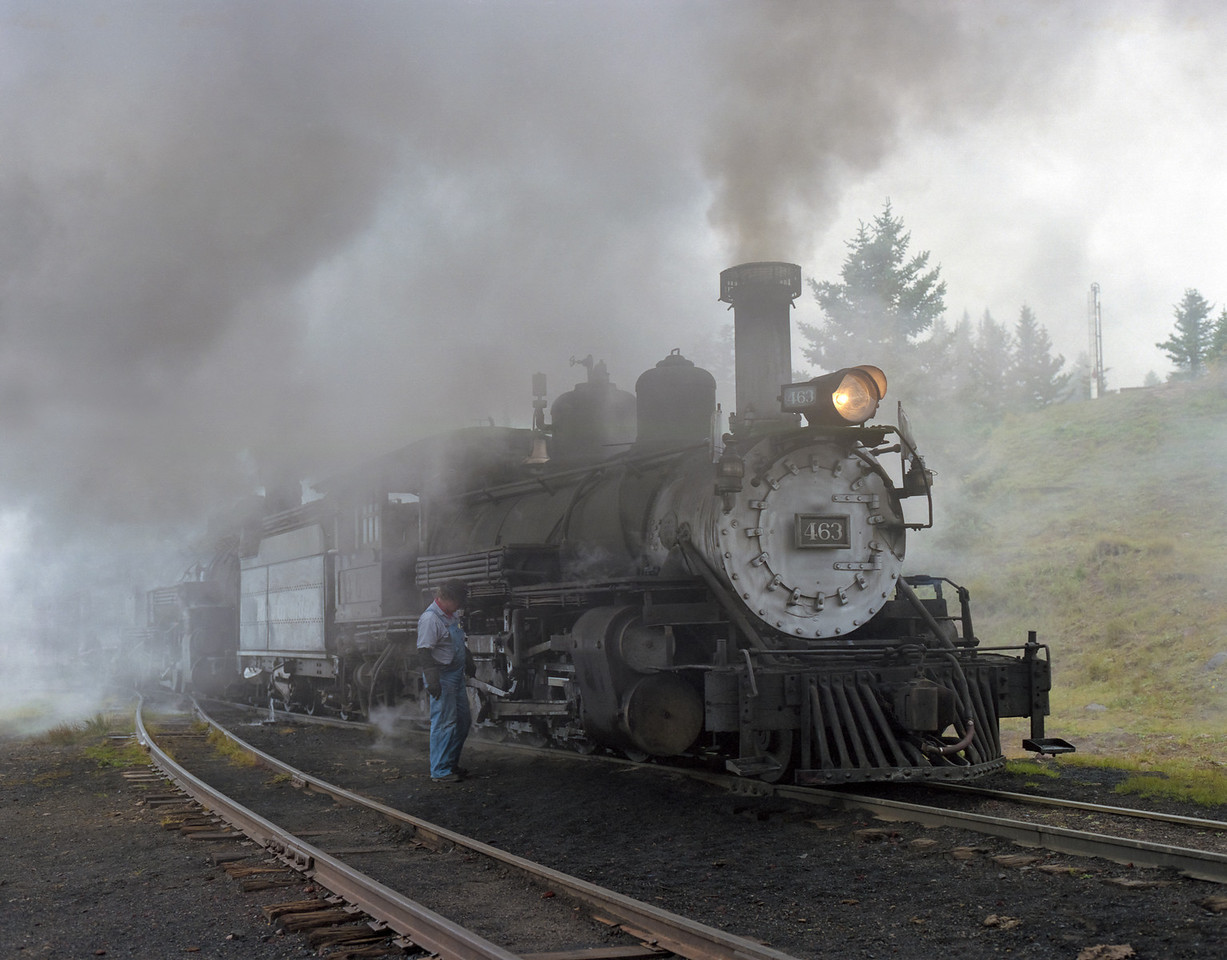 Cumbres & Toltec Narrow Gauge Railway double-headed steam engines pull a freight train through the New Mexico and Colorado mountins.