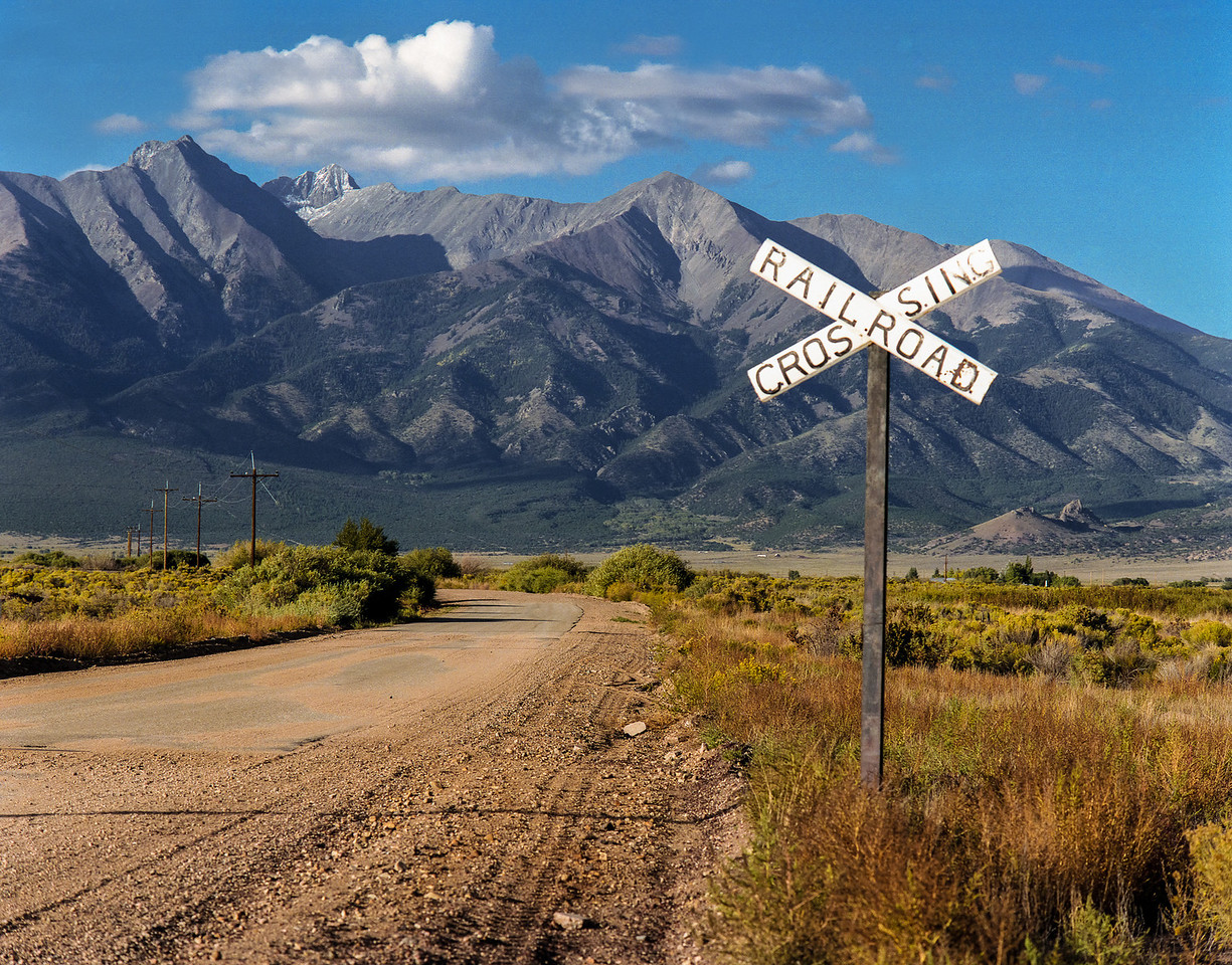 Railroad Crossing & Moutains