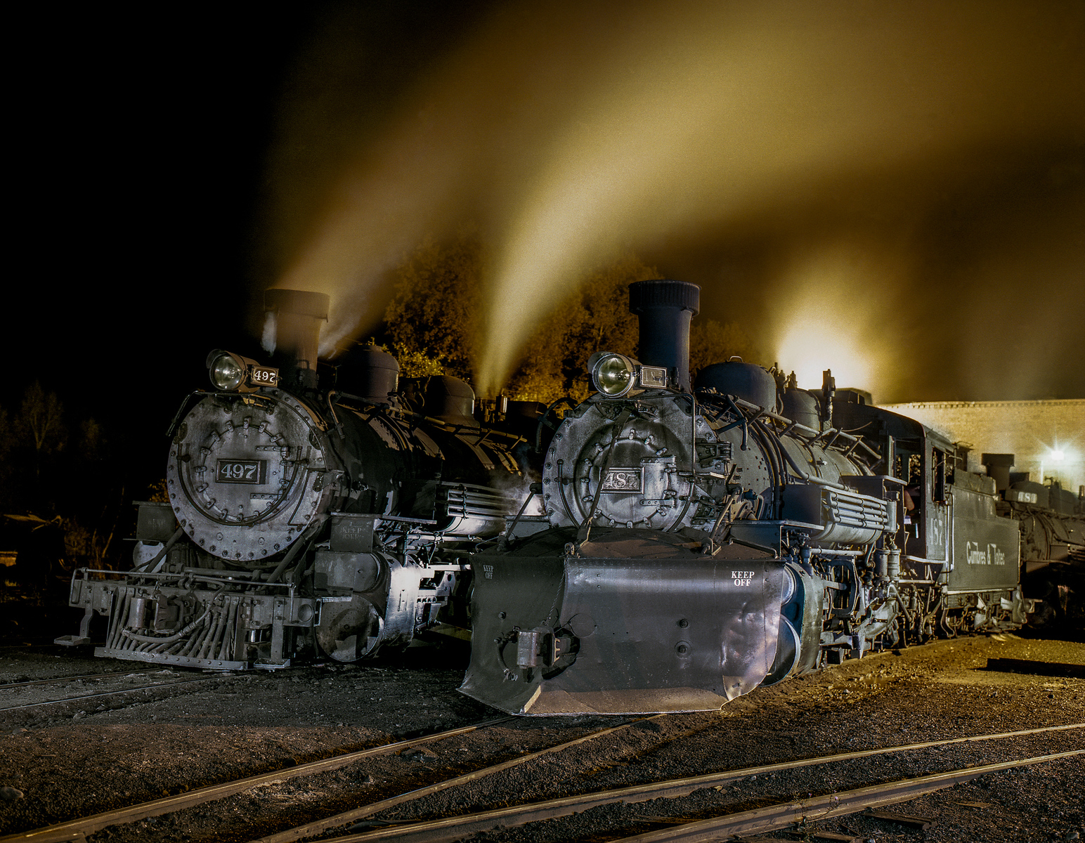 Two Cumbres & Toltec Narrow Gauge Engines at Night