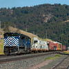 A westbound Montana Rail Link freight nears the summit of Bozeman Pass near Bozeman, Montana on July 19, 2012.